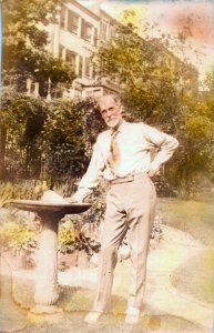 Reginald Pelham Bolton in common garden area behind his home